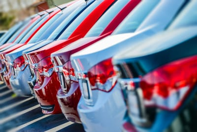 learn why dealerships are charging crazy car prices